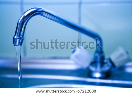 pure water which flows from the crane on kitchen
