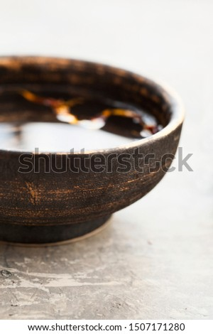 Pure water with organic leaf elements in a beautiful ceramic bowl. Still Life Photography. #1507171280