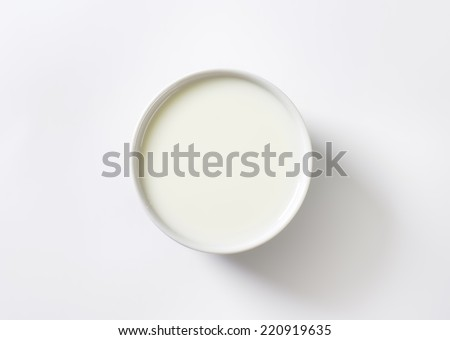 pure white view of bowl with milk