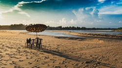 Puri Beach with Beach Umbrella and chairs for tourists  at the time of Sunset.