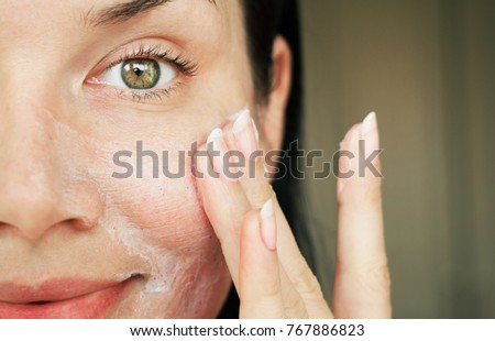 purification of the face. girl washed with scrub to clean the pores.