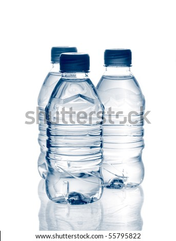 purified spring mineral water in the bottles with reflection. Is not isolated