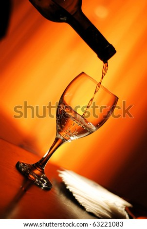 puring a glass of wine