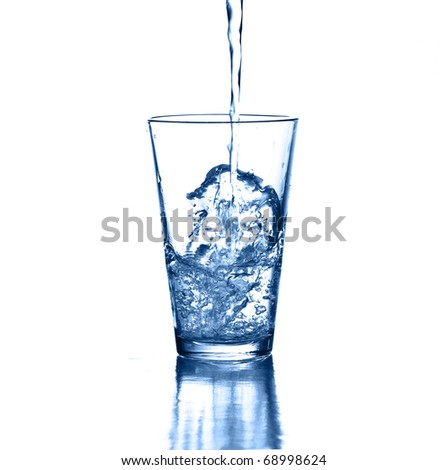 puring fresh water on glass on white background