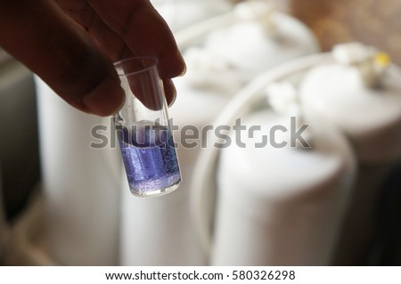 Purity of the filtered water by using alkaline tester with the blurry background of water filter
