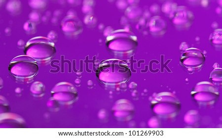 Purple abstract translucent water drops background, macro view