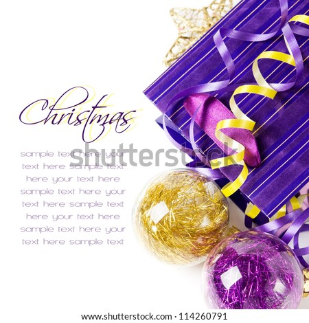 Purple and golden xmas baubles with copy space