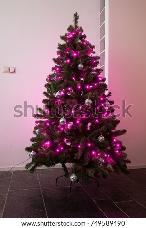 purple and silver christmastree in a living room at christmas