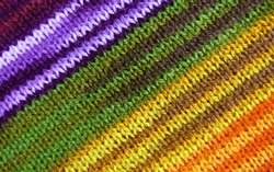 Purple and Yellow Tone Striped Alpaca Knitted Wool Fabric Texture in Diagonal Patterns for Abstract Background