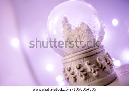 purple background fairy lights snowglobe