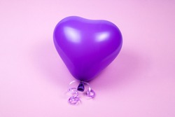 Purple ballon on purple background. Copy space.