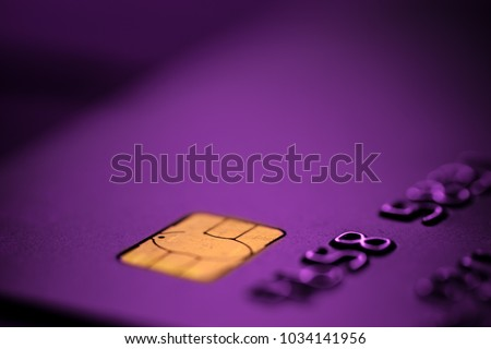Purple bank credit or debit card with negative copy space, suitable for adding text, macro shot