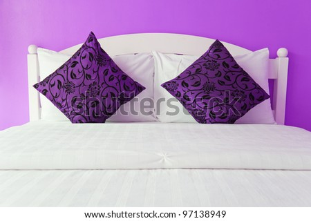 Purple bedroom in a modern house - home interiors.