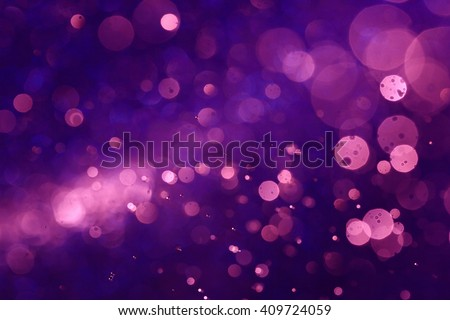 Purple bokeh abstract background caused by spray water. #409724059