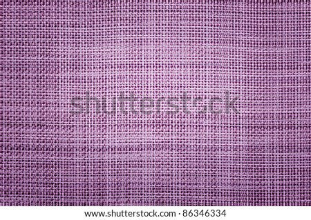 purple braided napkin, decorated background - stock photo