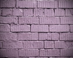 Purple brick wall. Background seamless texture wall of cinder block painted in lavender color. Vignetting.