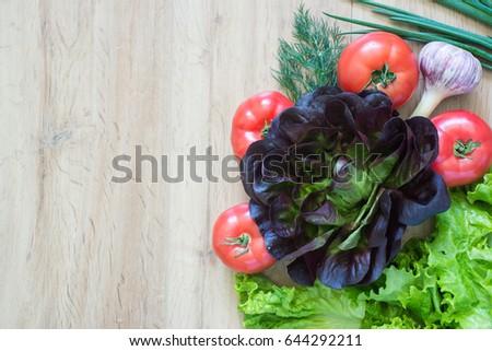 Purple cabbage, garlic, tomato, greens, copy space #644292211