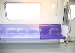 Purple chair and windows in electric train
