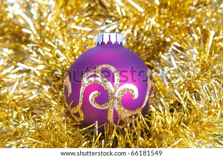 purple christmas ball in gold decorations
