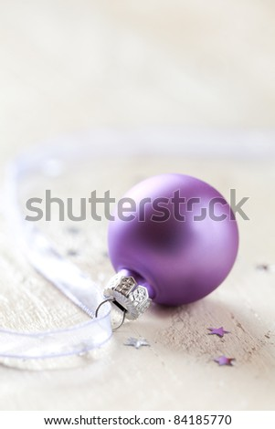 purple christmas ball with ribbon and decoration