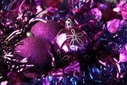 Purple Christmas baubles and tinsel