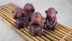 Purple clay art wise monkeys