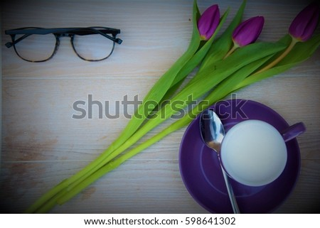Purple coffee mug in white wooden tray with vase, tulip, glasses - Shutterstock ID 598641302