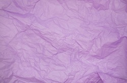 purple color creased paper tissue background texture. wrinkled tissue paper texture