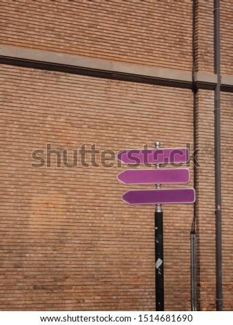 Purple directional arrows on the street #1514681690