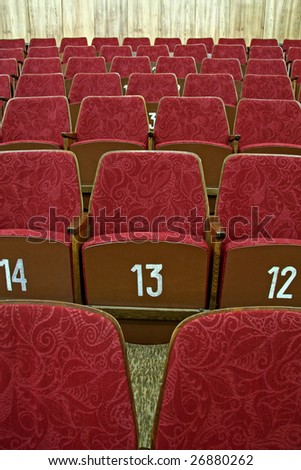 purple empty cinema seats with white numbers,