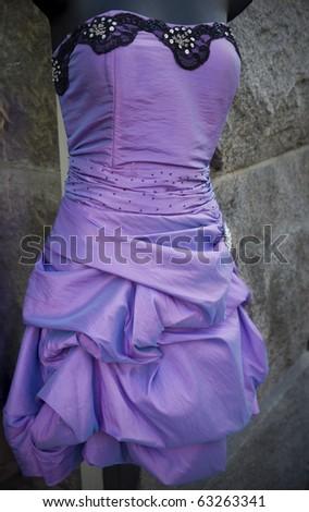 Purple evening gown outside an ethnic shop in the Noerrebro area of Copenhagen, Denmark.