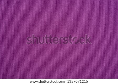 Purple fabric texture background. Natural fabric texture. Fabric background.