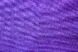 Purple fabric texture of empty shirt element. Blank cotton cloth background, colorful dark blue surface of rough jacket material