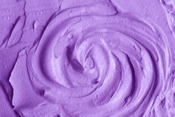 Purple facial cream (alginate face mask, body wrap, hair conditioner) texture close up, selective focus. Lavender abstract background with circle brush strokes.