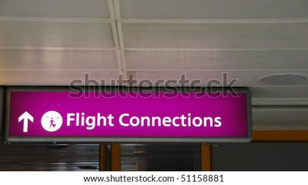purple flight connections sign at a international airport
