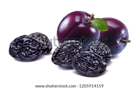 Purple fresh and dried plums isolated on white background. Package design element with clipping path. Horizontal composition