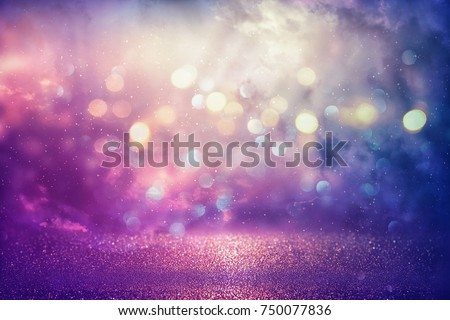 Photo of  Purple glitter lights background. defocused