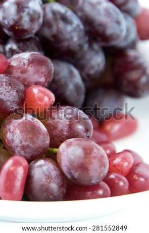 purple grapes vs purple jelly beans - snack decision between healthy food or junk food