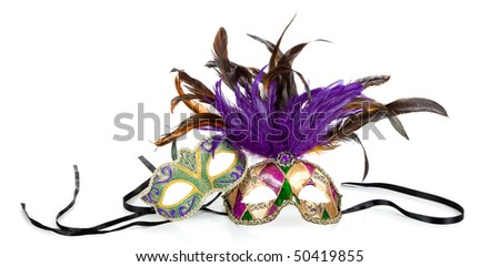Purple, green and gold mardi gras masks on a white background