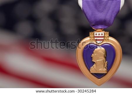 Purple Heart Against a Blurry American Flag. - stock photo