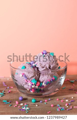 Purple Ice Cream Scoops in a Bowl with Sprinkles