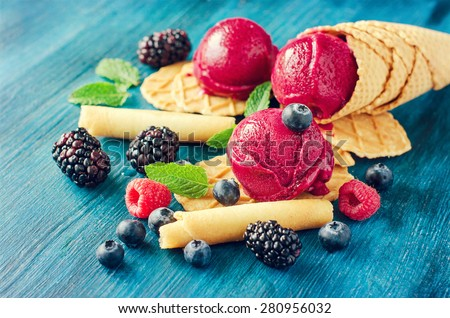 Purple ice cream with waffles and berries, sorbet, healthy dessert rustic ice cones