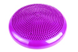 Purple inflatable balance disk isoleated on white background, It is also known as a stability disc, wobble disc, and balance cushion.