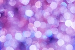 Purple Lights Festive background. Abstract bright background with bokeh defocused purple lights