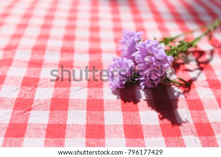 Purple Marguerite Daisy Flowers On Red Checkered Tablecloth  Background.Ultra Violet For 2018.Copy