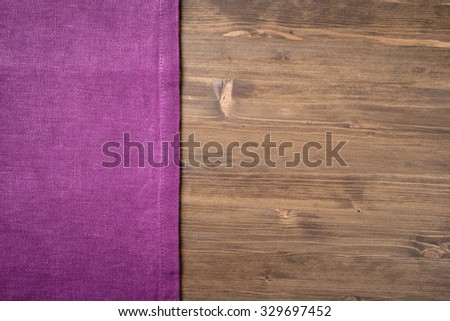Purple  napkin from left side wooden table top view