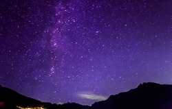 purple night sky stars and milky way over mountains