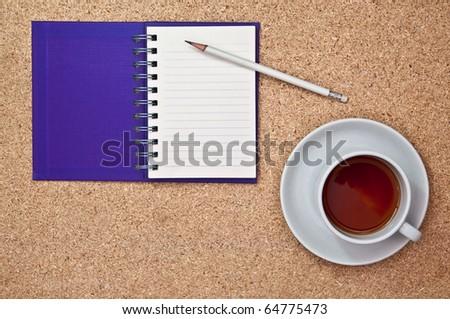 purple notebook on cork board - stock photo