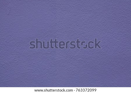 Purple painted stucco wall. Background texture. #763372099