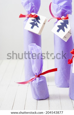 purple paper wrapped gift bottles